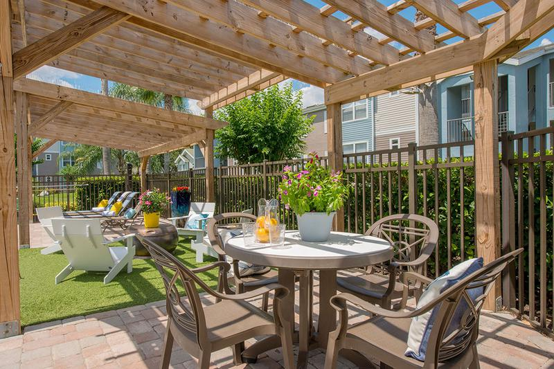 Poolside Pergola | Our expansive sundeck features a pergola to relax under.