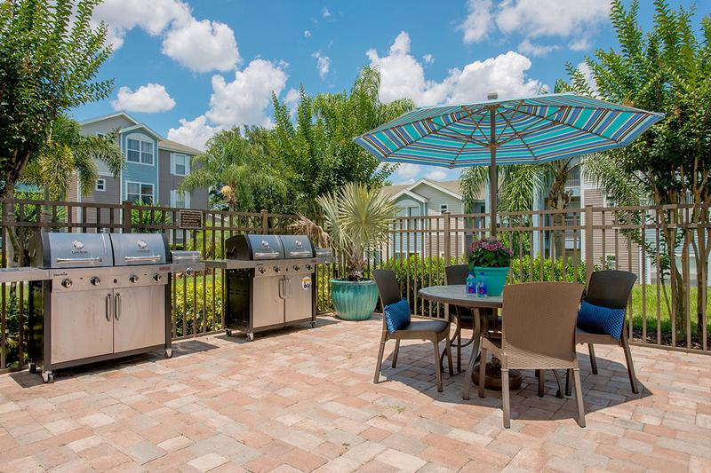 Outdoor Kitchen | Have a cookout by the pool at our outdoor kitchen featuring gas grills.