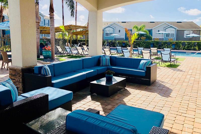 Outdoor Patio | Relax in the shade under out outdoor patio next to the pool, or sit at one of our many tables with umbrellas.