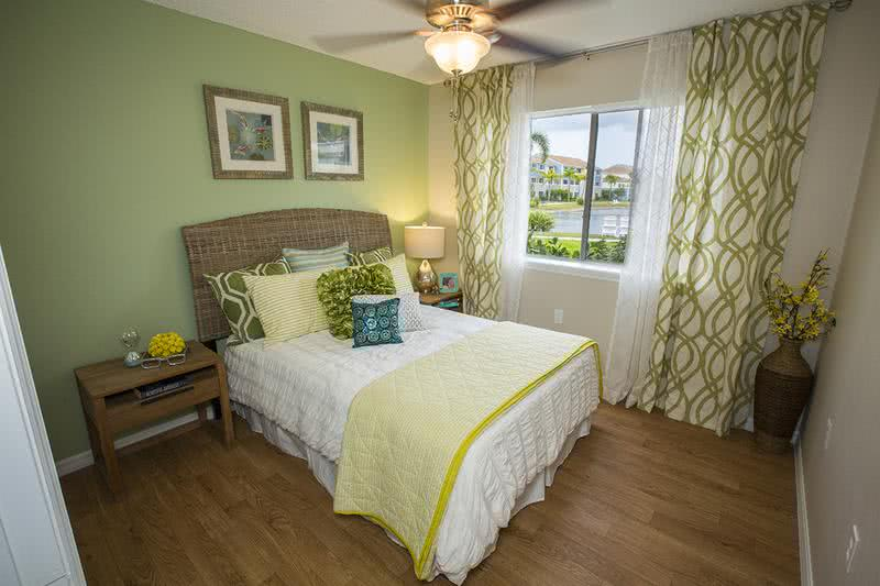 Guest Bedroom | Spacious bedrooms featuring a ceiling fan and wood-style flooring.