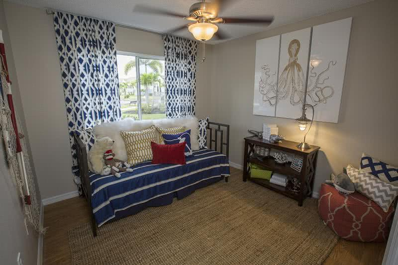 Guest Bedroom | Spacious guest bedrooms featuring large windows and ceiling fans.