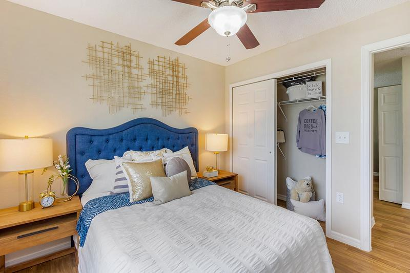 Guest Bedroom | Spacious guest bedrooms featuring large windows and ceiling fans, and a ceiling with built-in organizers.