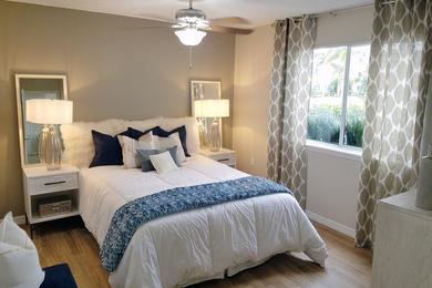 Master Bedroom | Spacious master bedrooms featuring wood-style flooring and a multi-speed ceiling fan.