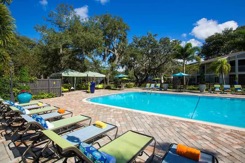 Florida Living at Its Best | Enjoy cooling off from the Florida sunshine at our beautiful pool, complete with loungers and cabanas.