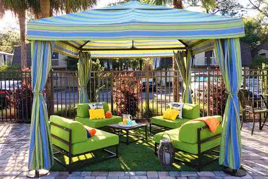 Poolside Cabanas | Our poolside cabanas is a great place to relax and have a drink.