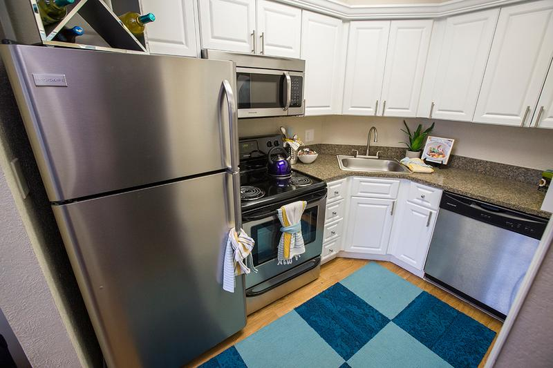 Kitchen | Our updated kitchens feature brand new cabinets, countertops and stainless steel appliances.