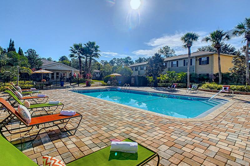 Expansive Sundeck | The Ridgemar Commons resort-style pool is equipped with free Wi-Fi for our residents, who are looking to take a break and relax after a busy day.