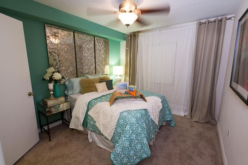 Bedroom | Your spacious bedroom features a modern ceiling fan and walk-in closet.