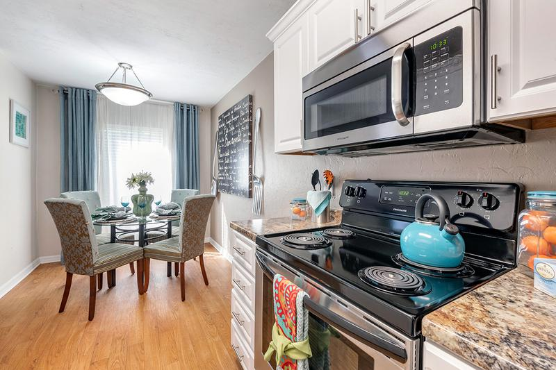 Stainless Steel Appliances | Kitchens feature stainless-steel appliances and granite-style countertops. Kitchens also open up to the separate dining area.
