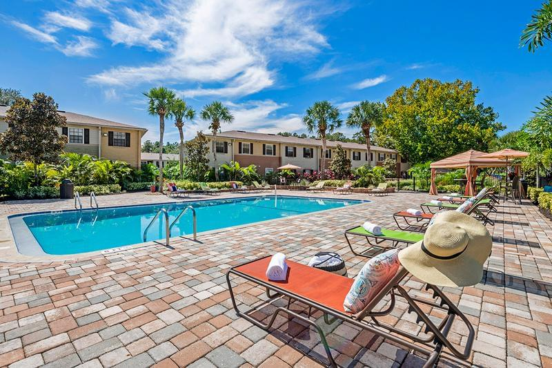 Resort-Style Pool | At the center of our community, is our newly renovated resort-style pool, with plenty of lounge seating, perfect for enjoying the Gainesville sun.