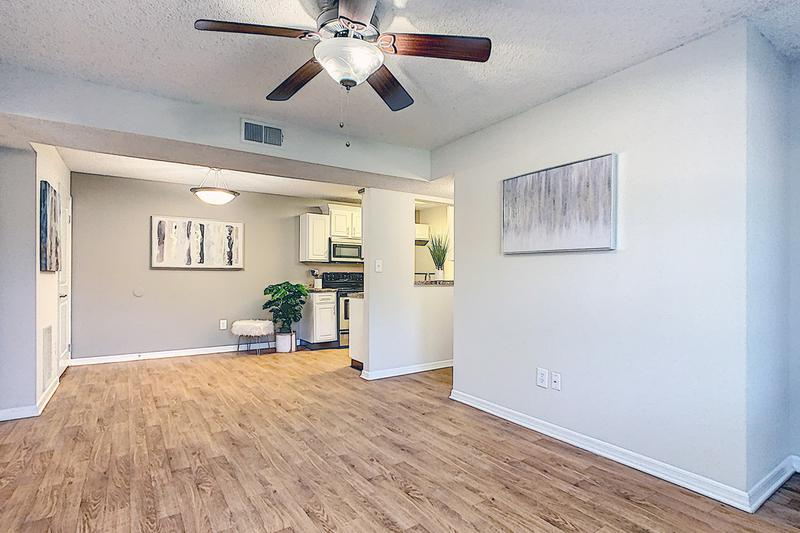 Spacious Open Floor Plans | Spacious open floor plans featuring wood-style flooring and multi-speed ceiling fans.