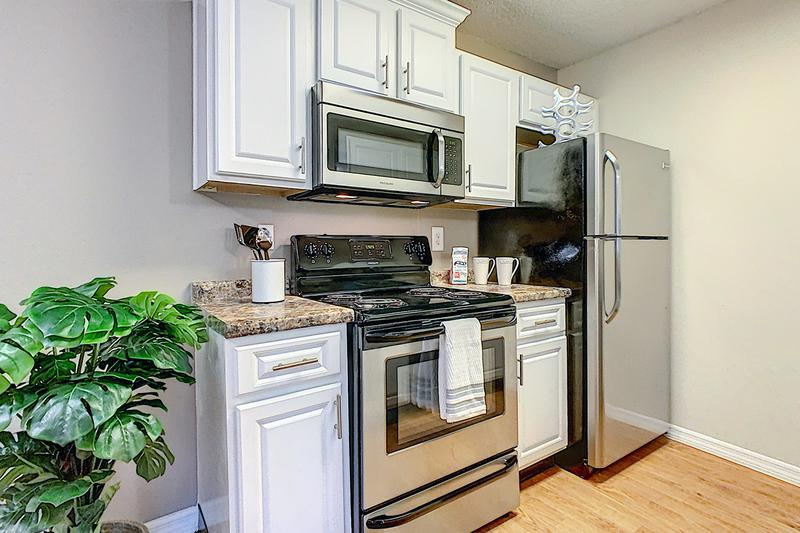 Updated Kitchens | Your newly renovated kitchen in the Deluxe Chateau floor plan features upgraded white cabinetry and modern stainless steel appliances.