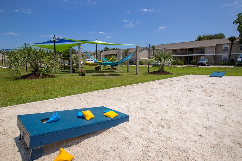 Corn Hole | Play a game of corn hole at our sanded game area located next to the hammock garden.