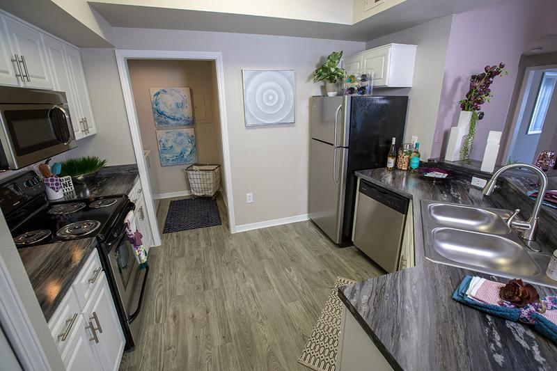 Kitchen | Your newly remodeled kitchen includes ample cabinet space and your very own laundry room.
