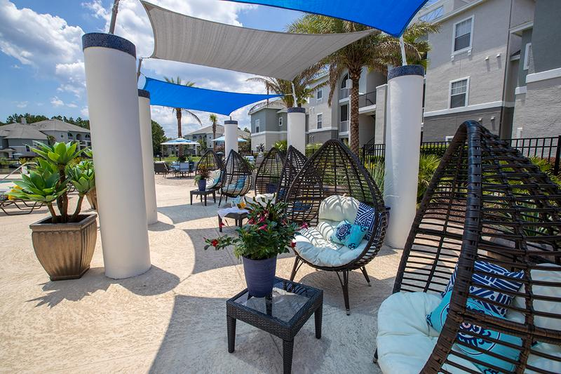 Poolside Seating | There is plenty of poolside seating, including a shaded area.