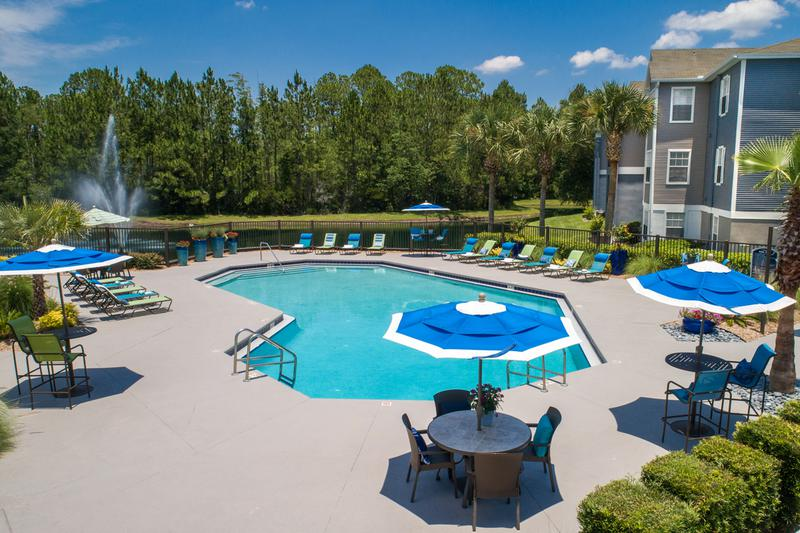 Expansive Sundeck | Our expansive sundeck includes plenty of poolside loungers and tables with umbrellas.