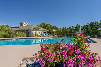Pool Area | Come relax at the pool area featuring beautiful lush landscaping.