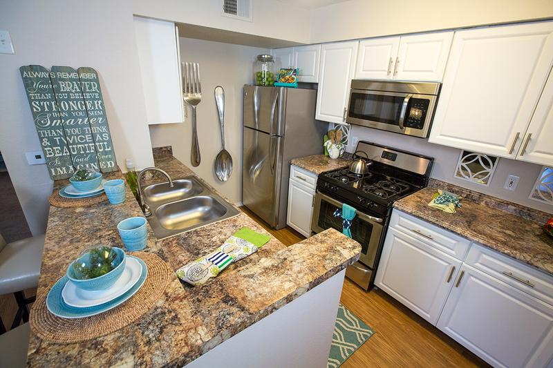 Updated Kitchens | Our updated kitchens feature wood-style flooring, granite-style counter tops and stainless steel appliances.