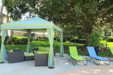 Cabanas | Relax in the shade under one of our poolside cabanas.