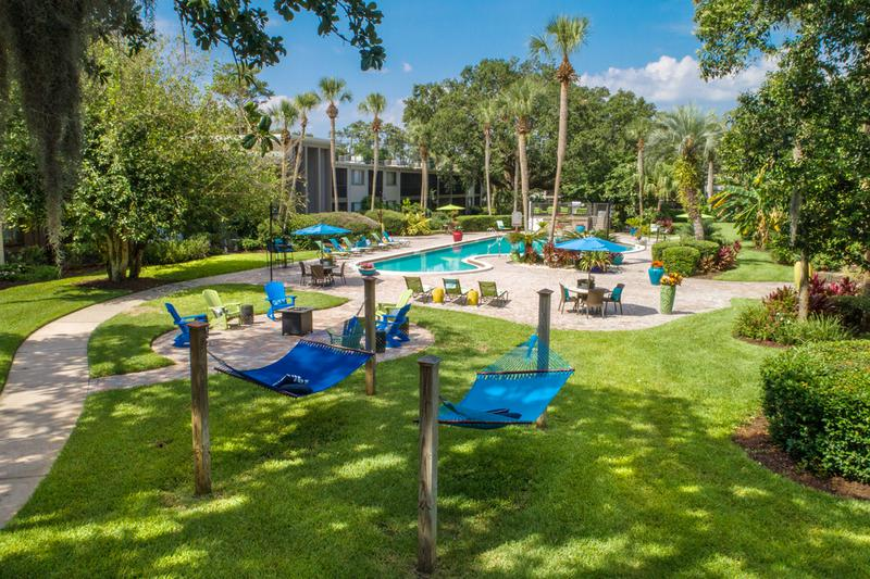 Outdoor Amenities | At Lakewood Village, you can enjoy plenty of outdoor amenities like a hammock garden, fire pit, and resort-style pool.