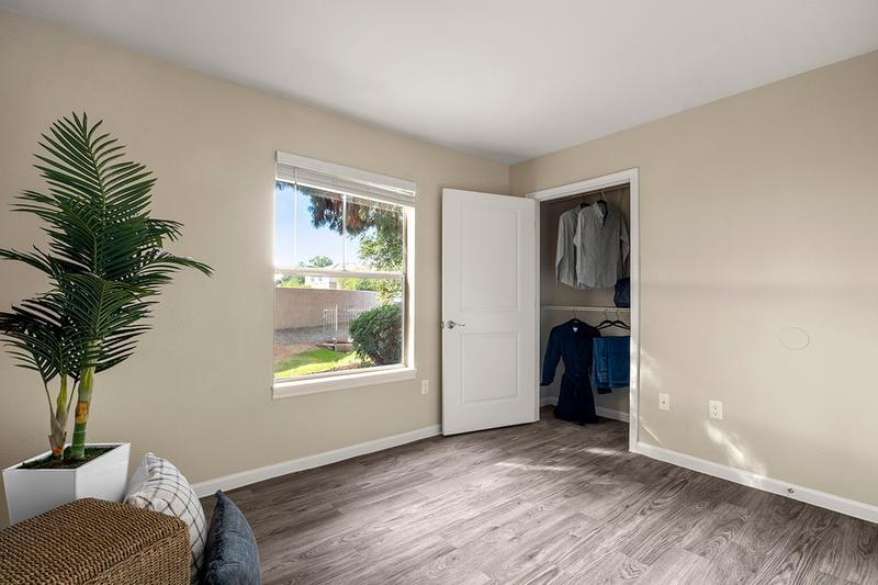 Guest Bedroom | Your new bedroom features a roomy closet, complete with built-in organizers for your convenience.