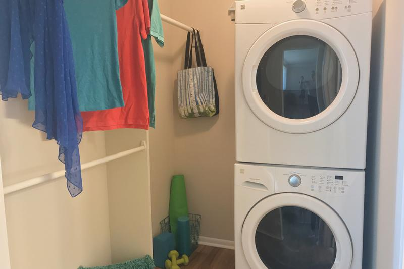 Studio Closet | Our studio apartments even feature a large walk-in closet with washer and dryer appliances.