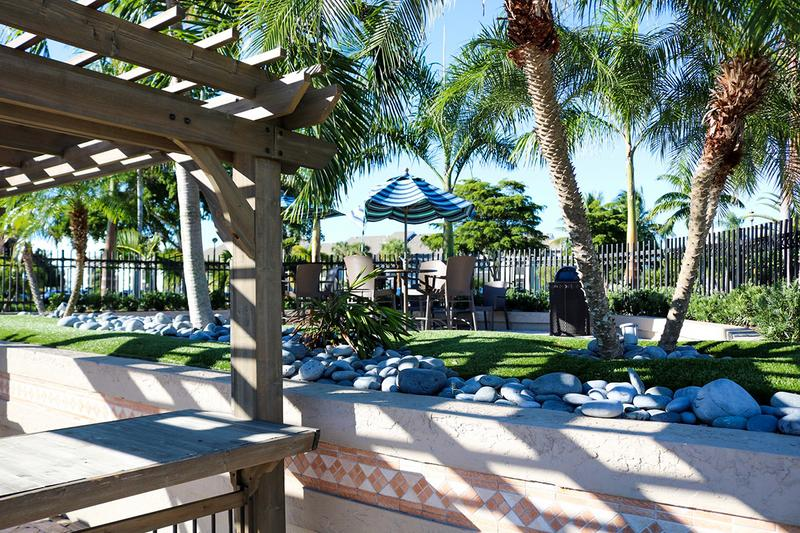 Poolside Tables | Umbrella seating areas located next to the pool.