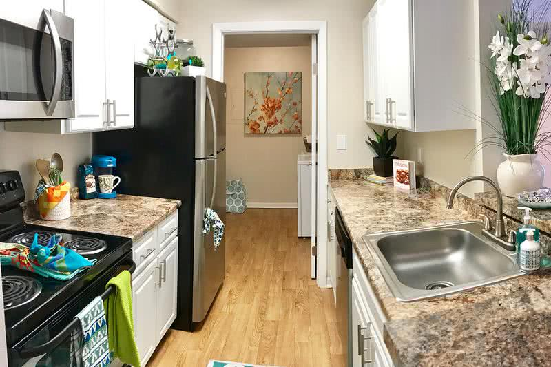 Fully Renovated Kitchens | Beautiful stainless steel appliances and marble style countertops included in every kitchen.