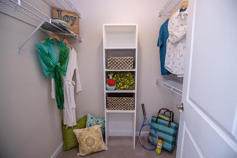 Walk-In Closet | Master bedrooms feature spacious walk-in closets with built-in shelving.