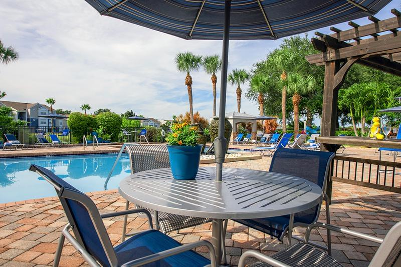 Poolside Tables | Redesigned pool overlooking Mallard's Landing Golf Course.