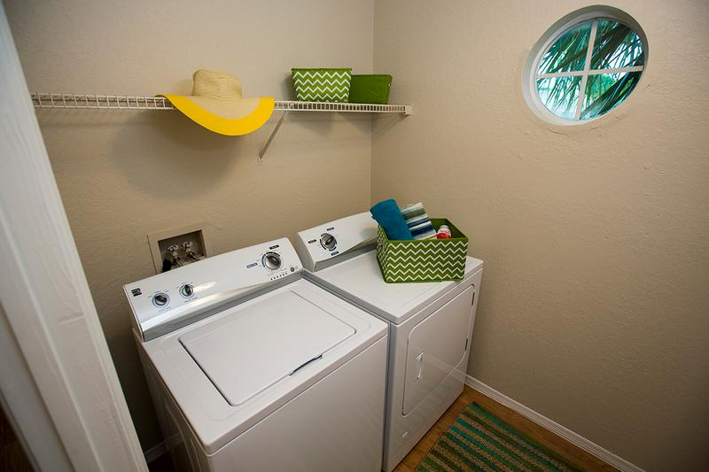 Laundry Room | Extra storage space and full-size washer and dryer appliances.