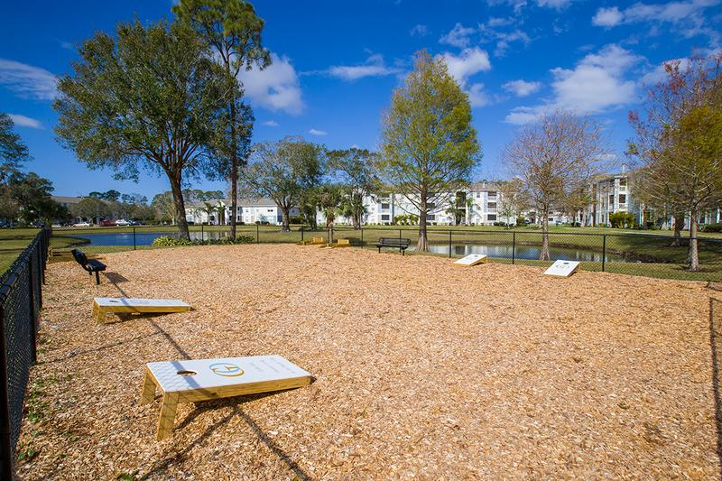 Game Area | Play some outdoor games in our fenced in game area including corn hole boards.