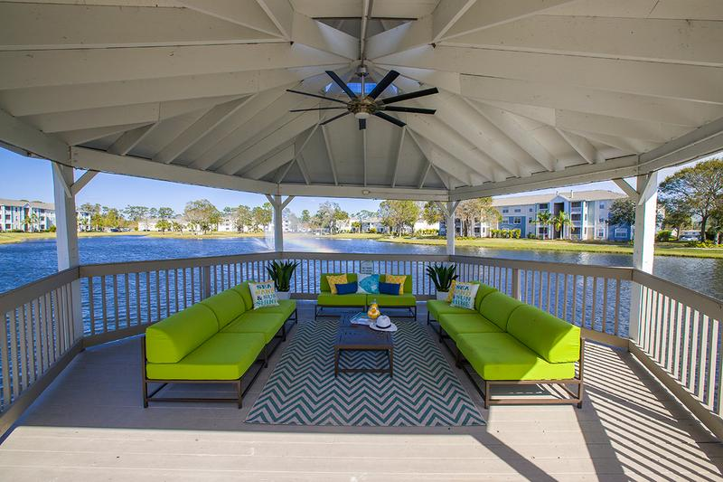 Dock Seating Area | Sit out by the water under our gazebo including seating and a fan.