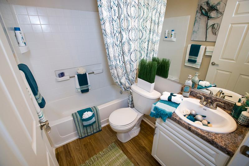 Bathroom | Remodeled bathrooms with updated flooring, countertops, cabinets and fixtures,