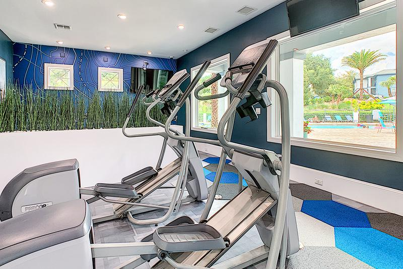 Ellipticals | Enjoy beautiful views of our pool while getting fit on the elliptical.