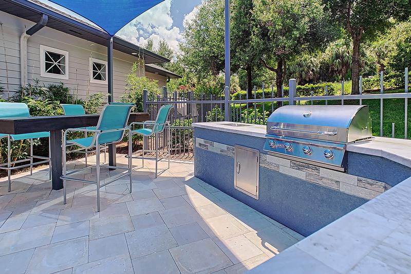 Outdoor Kitchen | Have a cookout at our poolside outdoor kitchen.