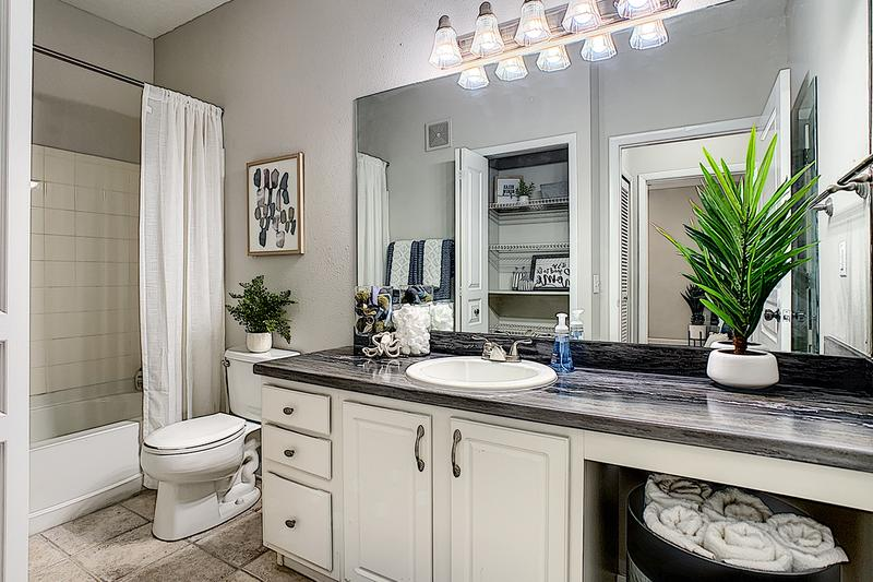 Master Bathroom | Newly renovated master bathrooms feature black fusion counter tops, and large mirrors.
