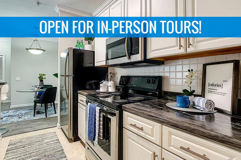 Newly Renovated Kitchens | Newly renovated kitchens featuring black-fusion counter tops, white cabinetry, and wood-style flooring. We are excited to offer in-person tours while following social distancing and we encourage all visitors to wear a face covering.