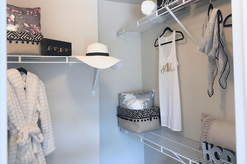 Walk-In Closets | Spacious walk-in closets featuring built-in organizers.
