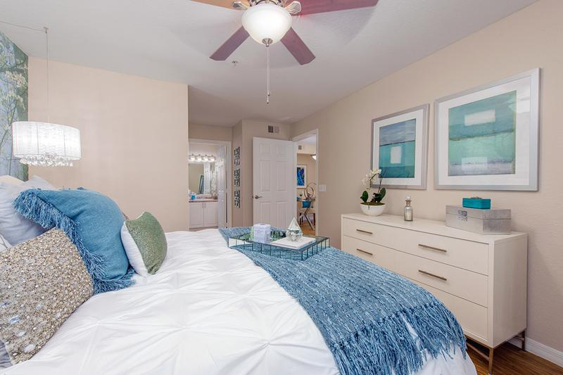 Master Bedroom | Over-sized master bedrooms featuring a ceiling fan, wood-style flooring and large windows.