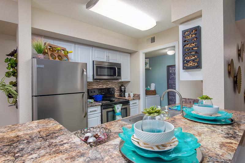 Kitchen with Breakfast Bar | Contemporary kitchens with breakfast bars, ideal for casual dining or entertaining. Laundry room is located next to the kitchen.