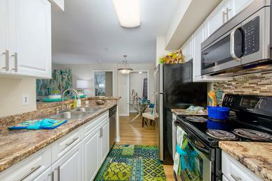 Galley Style Kitchens | Galley style kitchens featuring wood-style flooring and stainless steel appliances.