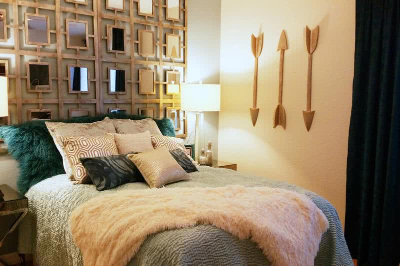 Guest Bedroom | Guest bedroom featuring wood-style flooring and large closets.