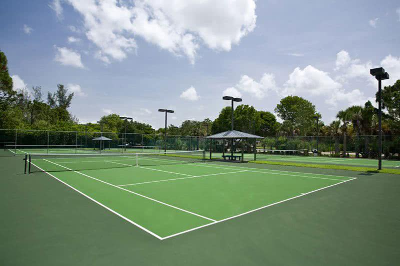 Lighted Tennis Courts | Our Naples community offers four tennis courts on-site.