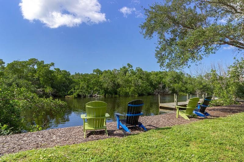 Riverfront Seating | Enjoy the picturesque riverfront views from around the Naples community.