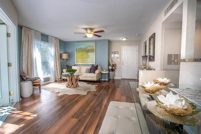 Living Room | Large living rooms with an abundance of natural light and can fit just about any sofa you desire.  Each newly remodeled apartment home has a new ceiling fan in the living room and all updated light fixtures  as well.