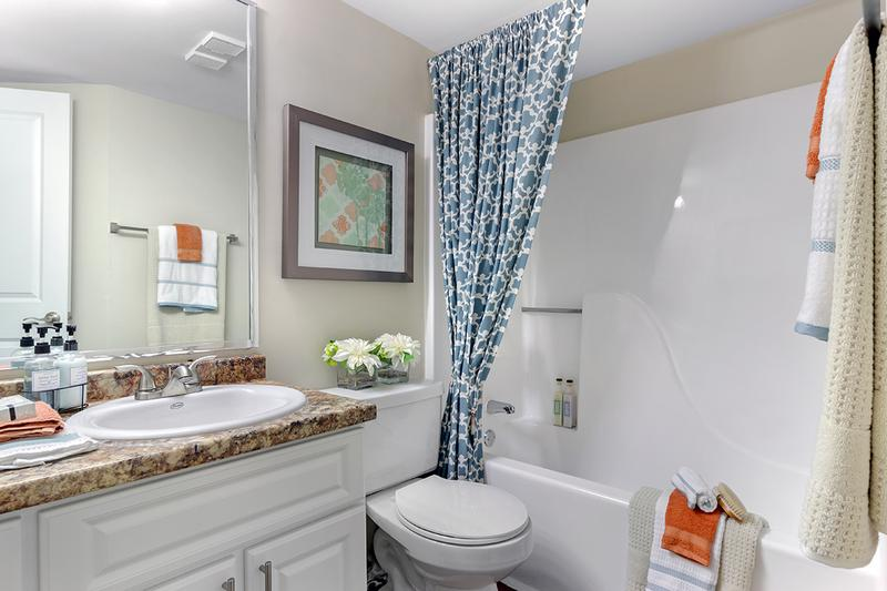 Guest Bathroom | Guest bathroom offers a great deal of counter space along with two entrances so guests never have to enter a bedroom to gain access.