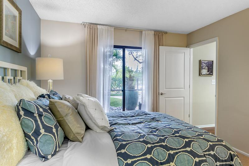 Lanai Access | The Rivieria Master Suite has it's own private entrance to the screened in lanai.
