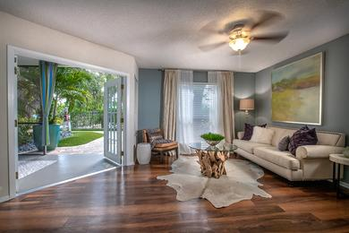 Living Room | Your spacious living room has doors leading to your very own private patio.