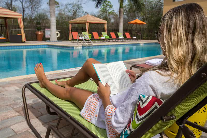 Poolside Loungers | Read a book by the pool on our sundeck, complete with plenty of poolside loungers.